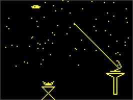 In game image of Atomica Spacewar on the Acorn Atom.