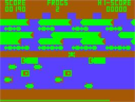 In game image of Frogger on the Acorn Atom.