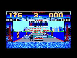 In game image of Cisco Heat: All American Police Car Race on the Amstrad CPC.