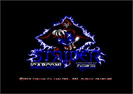Title screen of Strider on the Amstrad CPC.