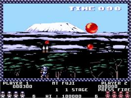 In game image of Pang on the Amstrad GX4000.