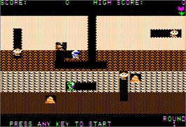 In game image of Dig Dug on the Apple II.