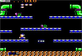 In game image of Mario Bros. on the Apple II.