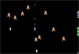 In game image of Robotron on the Apple II.