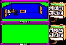 In game image of Spy vs. Spy on the Apple II.