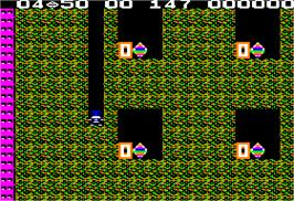In game image of Super Boulder Dash on the Apple II.