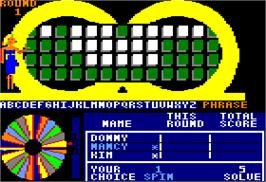 In game image of Wheel Of Fortune on the Apple II.