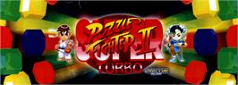 Arcade Cabinet Marquee for Super Puzzle Fighter II Turbo.