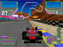 In game image of Ace Driver: Victory Lap on the Arcade.