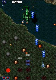 In game image of Aero Fighters on the Arcade.
