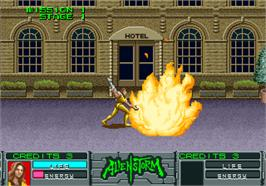 In game image of Alien Storm on the Arcade.