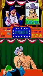 In game image of Arm Wrestling on the Arcade.