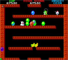 In game image of Bubble Bobble on the Arcade.