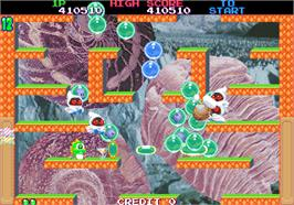 In game image of Bubble Memories: The Story Of Bubble Bobble III on the Arcade.