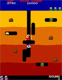 In game image of Dig Dug on the Arcade.