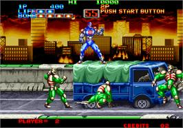 In game image of Eight Man on the Arcade.