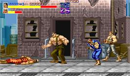 In game image of Final Fight on the Arcade.