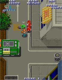 In game image of Gang Busters on the Arcade.
