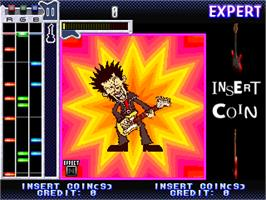 In game image of Guitar Freaks on the Arcade.
