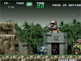 In game image of Gunforce - Battle Fire Engulfed Terror Island on the Arcade.