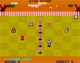 In game image of Hopping Mappy on the Arcade.