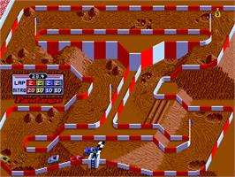 In game image of Ironman Ivan Stewart's Super Off-Road on the Arcade.