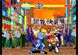 In game image of Karnov's Revenge / Fighter's History Dynamite on the Arcade.
