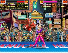 In game image of Knuckle Heads on the Arcade.