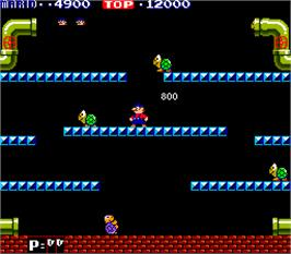 In game image of Mario Bros. on the Arcade.