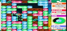 In game image of Mr. Driller on the Arcade.