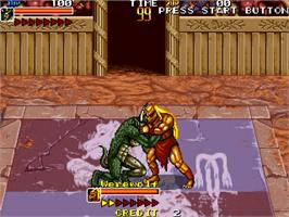 In game image of Mutant Fighter on the Arcade.
