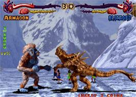 In game image of Primal Rage on the Arcade.