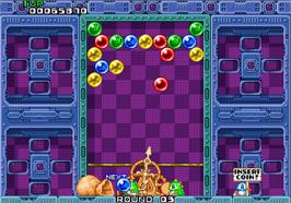 In game image of Puzzle Bobble on the Arcade.