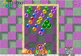 In game image of Puzzle Bobble / Bust-A-Move on the Arcade.