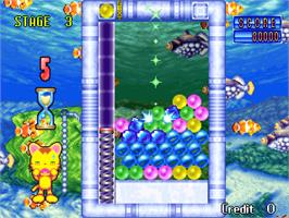 In game image of Puzzle Uo Poko on the Arcade.