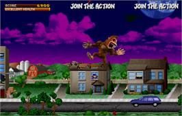 In game image of Rampage: World Tour on the Arcade.
