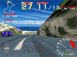 In game image of Ridge Racer on the Arcade.