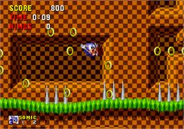 In game image of Sonic The Hedgehog on the Arcade.