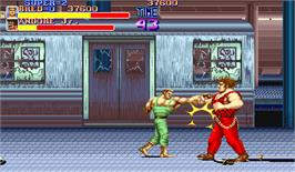 In game image of Street Smart / Final Fight on the Arcade.