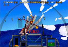 In game image of Strike Fighter on the Arcade.