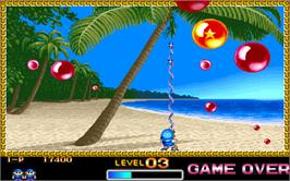 In game image of Super Buster Bros. on the Arcade.