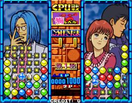 In game image of Taisen Tokkae-dama on the Arcade.