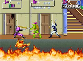 In game image of Teenage Mutant Hero Turtles on the Arcade.