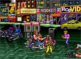 In game image of The Combatribes on the Arcade.