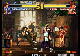In game image of The King of Fighters '95 on the Arcade.