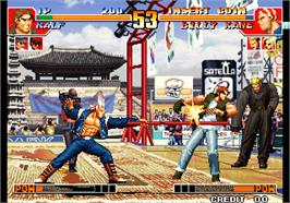 In game image of The King of Fighters '97 on the Arcade.