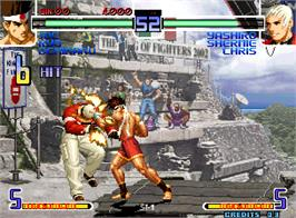 In game image of The King of Fighters 2002 Plus on the Arcade.