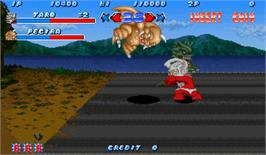 In game image of Ultra Toukon Densetsu on the Arcade.