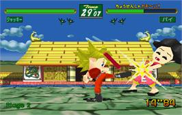 In game image of Virtua Fighter Kids on the Arcade.