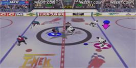 In game image of Wayne Gretzky's 3D Hockey on the Arcade.